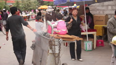 Young Chinese boy, street market, Lhasa Stock Footage