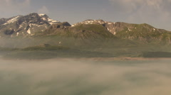 Mont Cenis artificial lake, fog rising in the morning summer landscape Stock Footage