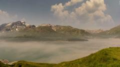 Fog lifting of Lac du Mont Cenis, Mont Malamot peak summer time lapse 4K Stock Footage