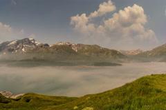 Fog gathering over Lac du Mont Cenis lake summer landscape time lapse 6K native Stock Footage