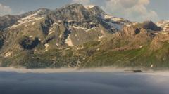 Alpine landscape Lac du Mont Cenis and Variselle fort morning fog Stock Footage