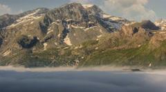 Lac du Mont Cenis covered in fog Ancien Fort de Variselle morning 4K Stock Footage
