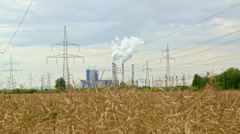 Coal powered electrical generation plant shot from distance in the afternoon Stock Footage