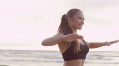 Girl is Doing Streching at Morning in Beach Stock Footage