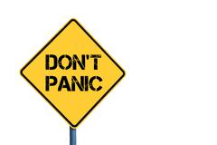 Yellow roadsign with Don't Panic message - stock photo