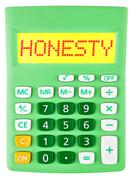 Calculator with HONESTY on display isolated - stock photo