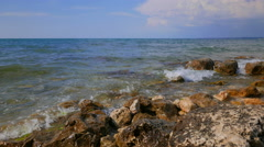 Stones in the water on the shore of the Black Sea. Hot summer day. Stock Footage