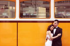 Bride and groom near tram - stock photo