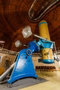 Old trophy large optical telescope - stock photo