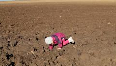 Little girl falling over on a fields Stock Footage