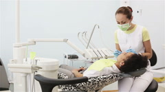 Oral hygiene, dental care: Doctor dentist working with patient in dental clinic Stock Footage