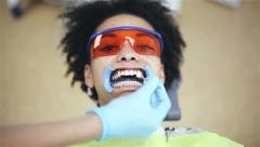 Oral hygiene, dental care: African american woman patient in a dental clinic Stock Footage