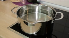 Casserole with water in the kitchen Stock Footage