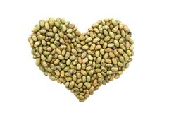 Roasted salted soy nuts in a heart shape Stock Photos
