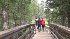 Teenage hikers head down the trail Stock Footage