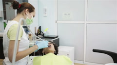 Oral hygiene, dental care: Doctor dentist working with patient in dental clinic - stock footage