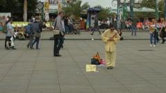 Asian woman bowing in Alexanderplatz, Berlin Stock Footage