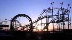 Roller coaster with blue sky. Amusement park. Sunrise, silhouette Arkistovideo