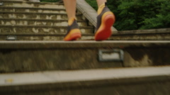 Closeup Shot of Young Girl is Climbing Stairs during Morning Run. Stock Footage