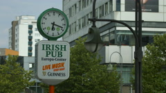 The Irish Pub - Europa Center sign and clock in Berlin - stock footage