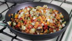 Mixture of vegetables prepared on a frying pan Stock Footage