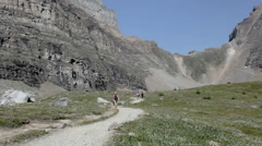 Hikers on Trail in Mountains Stock Footage