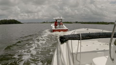 A Disabled Boat Getting Towed Stock Footage