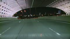 Tunnel & then Bridge on Freeway - stock footage