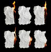 Paper burning on black background Stock Photos