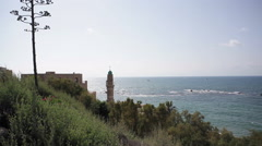 Mosque in Jaffa on the Mediterranean sea, Muezzin call for prayer Stock Footage