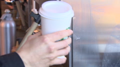 Handing over a take away coffee to a customer Stock Footage