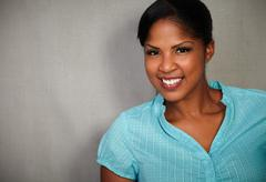 Stock Photo of Waist up portrait of a confident lady toothy smiling at the camera - copy spa