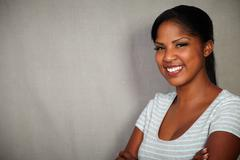 Horizontal portrait of a young african woman looking at the camera while smil - stock photo