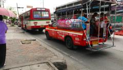 Pickup bus with passengers standing in traffic jam, parallax shot Stock Footage