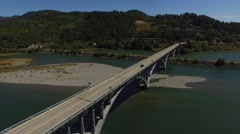 Aerial view of traffic on a concrete bridge in oregon | gold beach Stock Footage