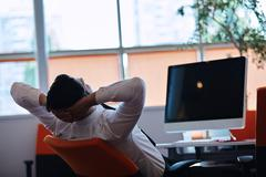 Young man sleeping in the office after a night shift Stock Photos