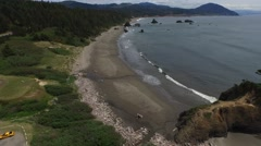 Flying over an overcast oregon beach | port orford Stock Footage