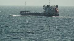 A cargo merchant ship crossing the sea Stock Footage