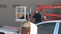 Electrocuted man on cherry picker Stock Footage
