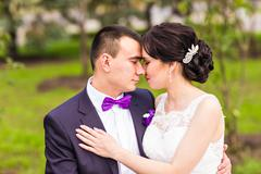 Bride and Groom at wedding Day walking Outdoors on autumn nature - stock photo