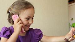 Little smiling girl talking on cell phone, Slow Motion - stock footage