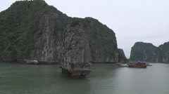 Village and rocks on the water Hạ Long Bay, North Vietnam Stock Footage