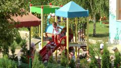 Kids playing in kindergarten playground - stock footage