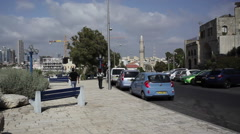 Muezzin mosque call for prayer in Jaffa, pan left to Tel-Aviv coast Stock Footage