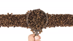 Magnifying glass increases the coffee beans, motion up Stock Footage