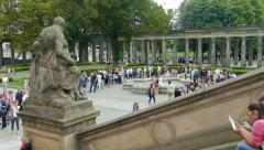 People waiting in a long queue to the Old National Gallery in Berlin, Germany Stock Footage
