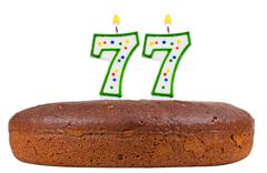 Birthday cake with candles number seventy seven Stock Photos