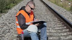 Railway Engineer with documentation on railway Stock Footage