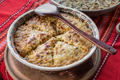 Potato pie with vegetables and cheese. Bulgarian national dish Stock Photos