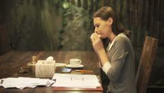 Pretty businesswoman with a cold sitting by table at home at night HD Stock Footage